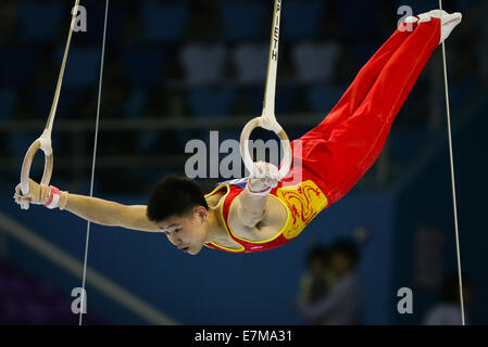 Incheon, South Korea. 21st Sep, 2014. Wang Peng of China competes during the rings of men's gymnastics artistic - Stock Photo