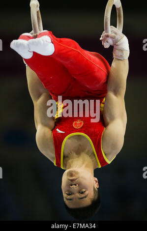 Incheon, South Korea. 21st Sep, 2014. Liao Junlin of China competes during the rings of men's gymnastics artistic - Stock Photo