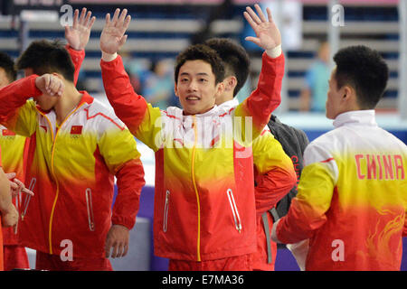 Incheon, South Korea. 21st Sep, 2014. Zou Kai of China greets audiences before the men's gymnastics artistic event - Stock Photo