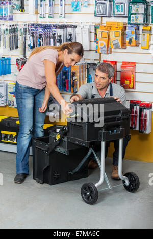 Salesman Showing Tool Case To Customer In Store - Stock Photo