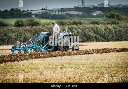 Agriculture - a farmer competing in a ploughing competition on The Lizard in Cornwall. - Stock Photo