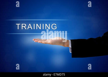 training button with business hand on a touch screen interface - Stock Photo
