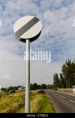 National Speed Limit sign on a country road - Stock Photo