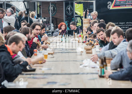 Warsaw, Poland. 21st September, 2014. People eats food during food trucks festival in front of Palace of Culture - Stock Photo