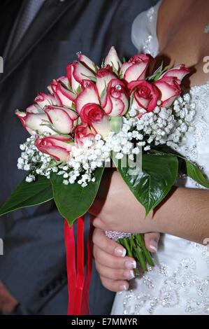 Bride holding bridal bouquet (detail)