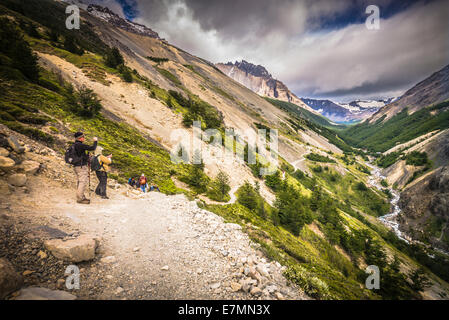 Hiking on the Base of the Towers classic trail in Patagonia, Chile. - Stock Photo