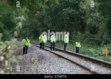 London, UK. 21st Sep, 2014. British Transport Police search railway tracks and scrub in an expanded search area - Stock Photo