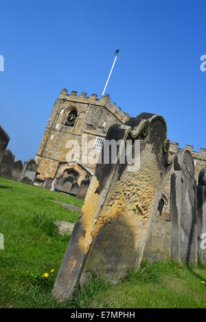 Close up of grave with Church St Marys in background Whitby - Stock Photo