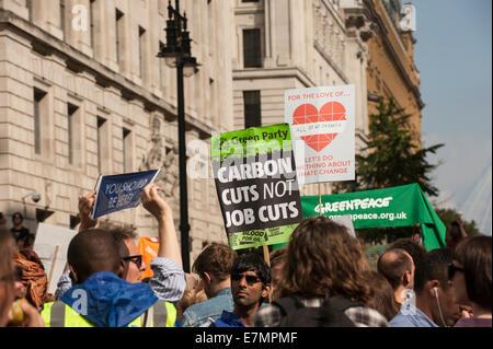 London, UK. 21st Sep, 2014. Marchers hold placards aloft at the Climate Change demonstration, London, 21st September - Stock Photo