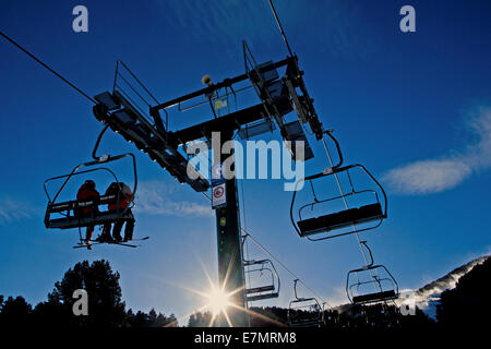 Chairlifts on their way to top of the mountain ski resort in Spain - Stock Photo