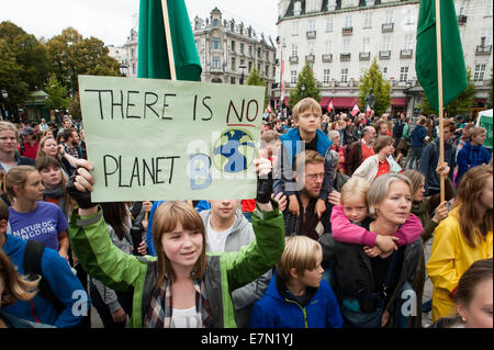 Oslo, Norway. 21st Sep, 2014. A sign reads, 'There Is No Planet B', as parents carry children among thousands marching - Stock Photo