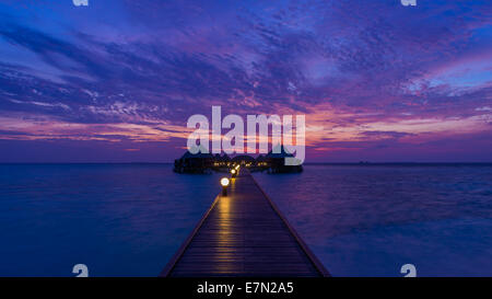 Gorgeous sunset over the ocean. Panorama of tropical island. Maldives - Stock Photo