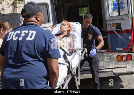 DCFD EMT loading patient into ambulance - Washington, DC USA - Stock Photo