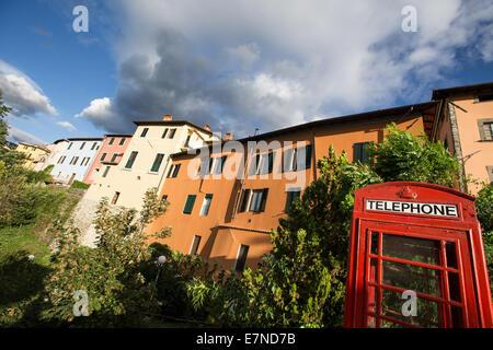 Red telephone box, Barga, Tuscany, Italy, holiday, weekend break - Stock Photo