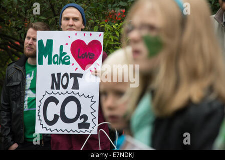 Oslo, Norway, 21st Sep, 2014. A sign reads, 'Make Love, Not CO2', as thousands march through central Oslo, Norway, - Stock Photo