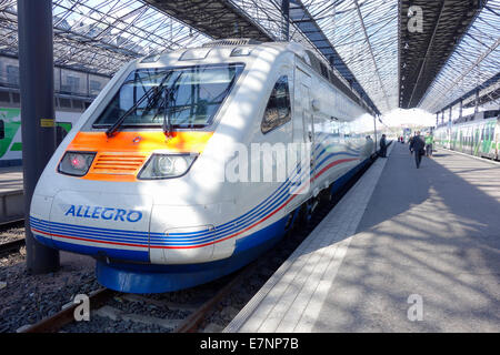 FInland, Helsinki: Passengers board an Allegro, high-speed electric tilting train in the main railway station in - Stock Photo
