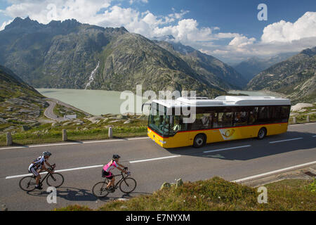 Postbus, riding a bicycle, Grimsel Pass, glacier, ice, moraine, bicycle, bicycles, bike, riding a bicycle, racing - Stock Photo