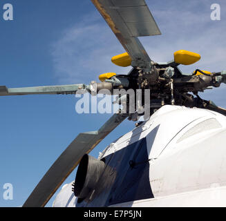 civil helicopter rotor mechanism detail. part of copter propeller - Stock Photo