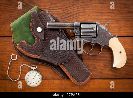 antique revolver with holster - Stock Photo