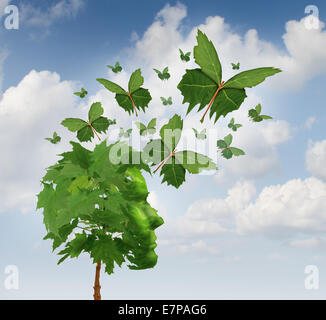 Creative communication and intelligent marketing concept as a tree shaped as a human head with flying leaves turning - Stock Photo