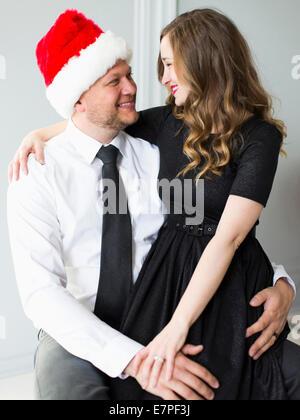 Studio portrait of young couple - Stock Photo