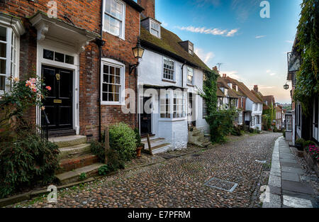 Picturesque cottages on a cobblestone street in the town of Rye in East Sussex - Stock Photo