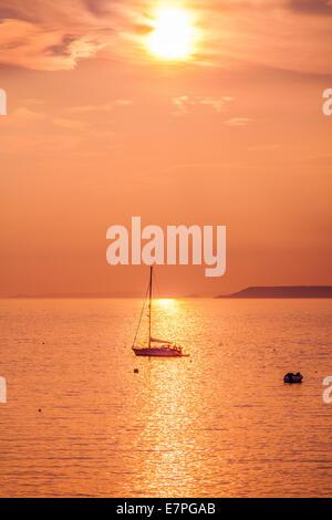 Sunset over the sea at Hope Cove, South Devon, Devon, England, United Kingdom. - Stock Photo