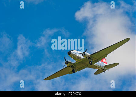 A vintage Douglas DC-3 (Dakota) aircraft of Swissair, coming in to land - Stock Photo