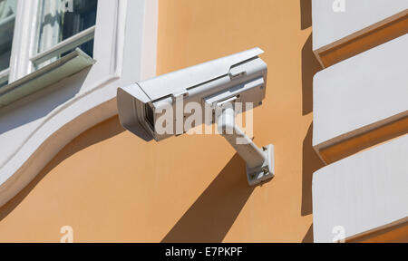 Security or cctv camera on wall background - Stock Photo