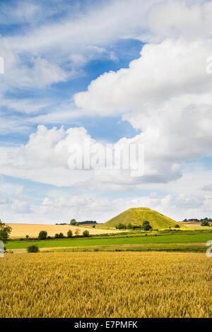 Bronze Age Silbury Hill near Avebury in Wiltshire in high summer UK - Stock Photo