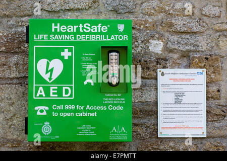 Heart safe  Automated External Defibrillator attached to a stone wall - Stock Photo
