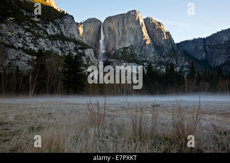 CALIFORNIA - Early morning mist on a frosty meadow below Upper Yosemite Fall in Yosemite Valley; Yosemite National - Stock Photo