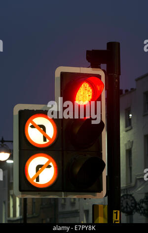Traffic lights on red with no right or left turn signs - Stock Photo