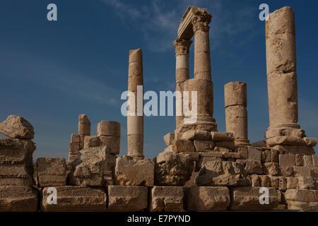 Ruins of the Citadel. Jebel al-Qalaa, Qala hill, columns of the roman Hercules temple in Amman Jordan - Stock Photo
