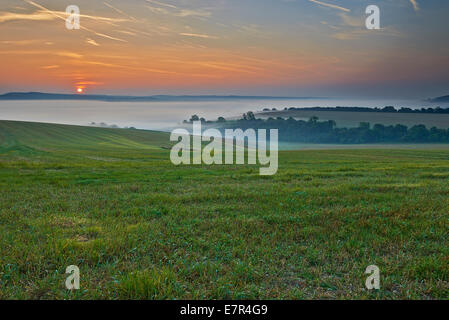 Early autumn equinox morning on September 23rd 2014 in the southdowns national park, showing the sun rising above - Stock Photo