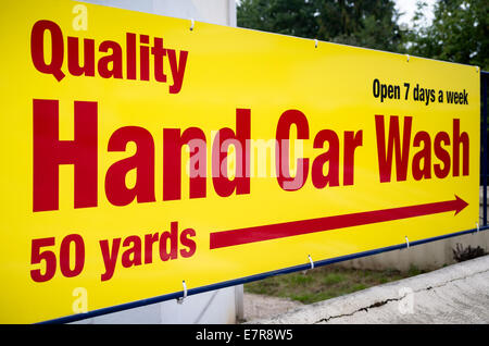 Sign pointing to a quality hand car wash service in UK - Stock Photo