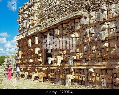 A couple inspecting the facade of El Palacio de los Mascarones - Stock Photo