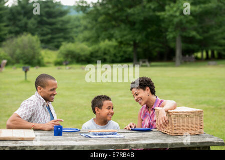 Family having a picnic in summer. - Stock Photo