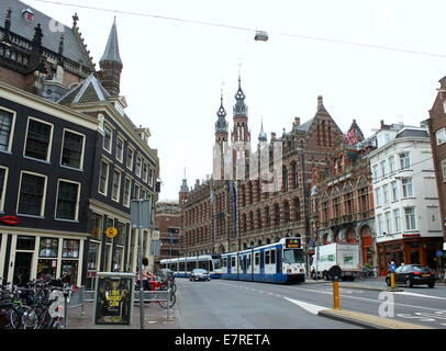 Magna Plaza shopping mall  at Nieuwezijds Voorburgwal 182, Amsterdam, Netherlands, city tram passing in front - Stock Photo