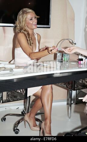 Paris Hilton promoting Alessandro products during her visit at the Beauty Fair.  Featuring: Paris Hilton Where: - Stock Photo
