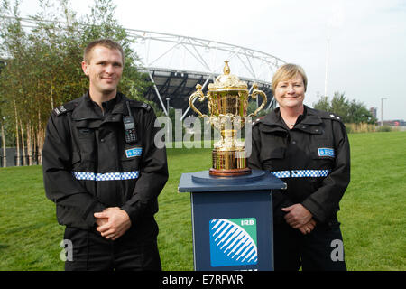 London, UK. 23rd September 2014. Newham police representatives during the Webb Ellis Cup on display, marking 1 Year - Stock Photo