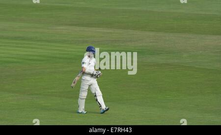Manchester, UK  23rd September 2014 Chris Rogers returns to the pavilion after being bowled out for 33 by Luke Procter. - Stock Photo
