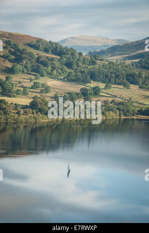 Lone sailing boat on Ullswater in the English Lake District - Stock Photo