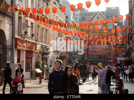 Street scene, with colourful chinese lanterns, Gerrard street, Soho, Chinatown London UK - Stock Photo