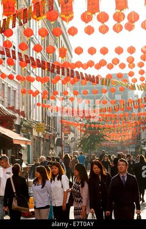 Chinatown, London, Gerrard Street scene with chinese lanterns, Soho, London UK - Stock Photo