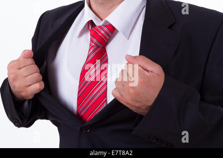 Businessman showing superhero suit, isolated on white. - Stock Photo