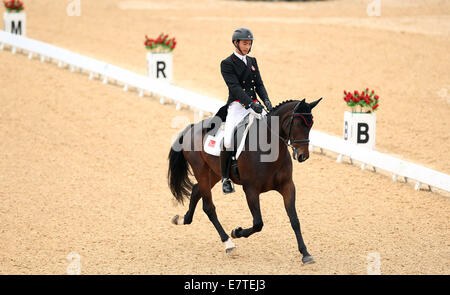 Incheon, South Korea. 24th Sep, 2014. Hua Tian of China competes during the eventing individual dressage match of - Stock Photo