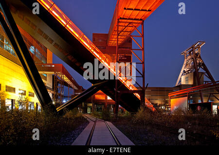 Illuminated gangway to the Ruhr Museum at the Zeche Zollverein Coal Mine Shaft XII with the headframe, Essen, Ruhr - Stock Photo