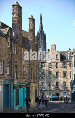 Candlemaker Row leading to Cowgate, in distance the gothic spire of The Hub' , the Old Town, Edinburgh, Scotland, - Stock Photo