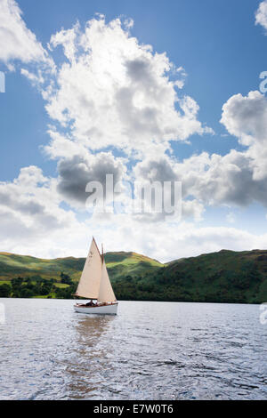 A sailing dinghy in the English Lake District on Ullswater, Cumbria UK - Stock Photo